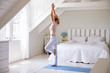 canvas print picture - Woman At Home Starting Morning With Yoga Exercises In Bedroom