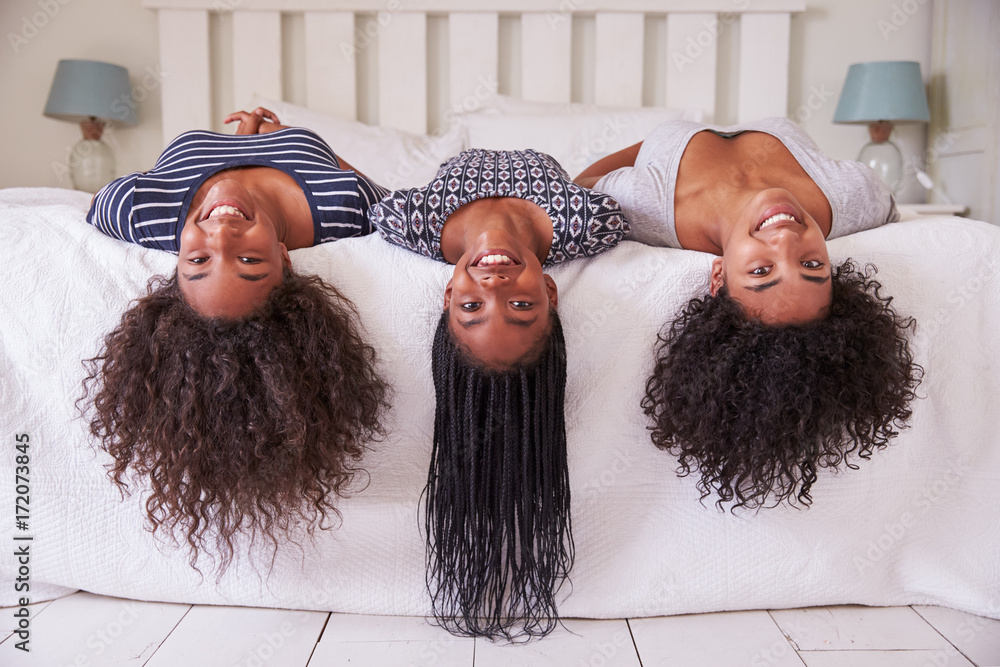 Fototapety, obrazy: Three Teenage Sisters With Long Hair Lying On Bed At Home