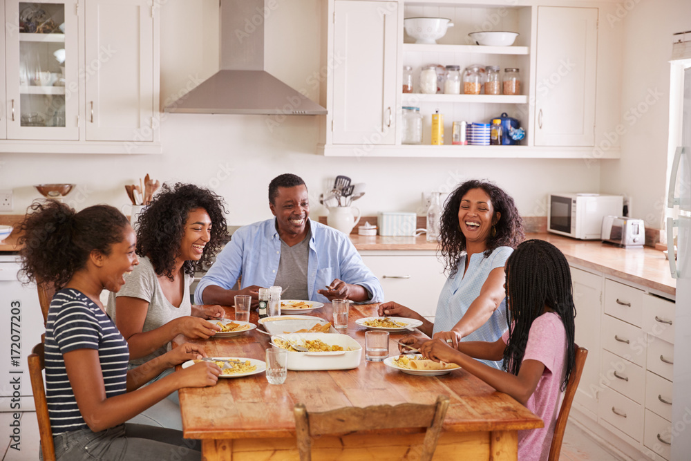 Fototapety, obrazy: Family With Teenage Children Eating Meal In Kitchen