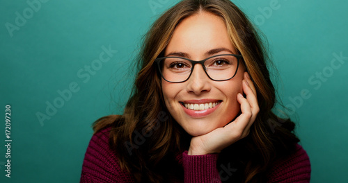 Photo  Smiling babe in glasses, looking at camera