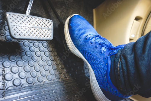 The gas pedal brake pedal on the blue shoes. Wallpaper Mural