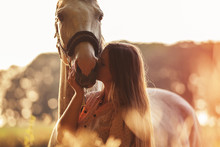 Woman Kissing Her Horse At Sun...
