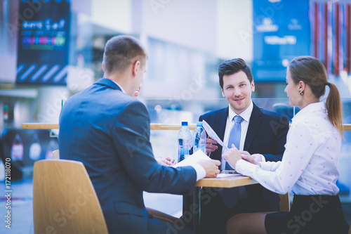 Fototapety, obrazy: Group of happy young business people in a meeting at office