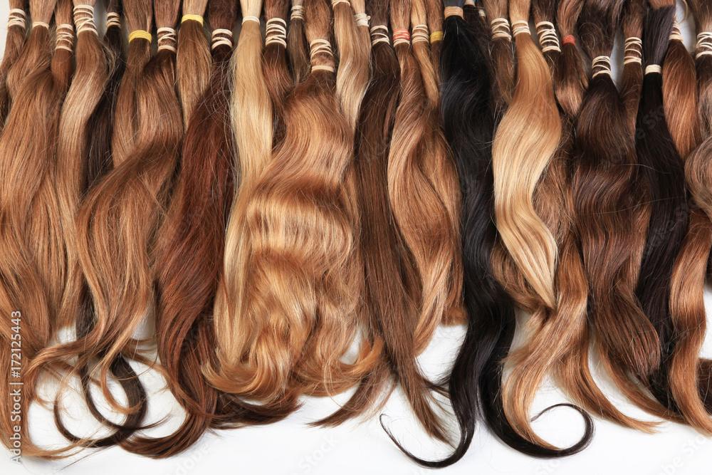 Fototapeta Hair extension equipment of natural hair. hair samples of different colors