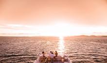 Tourist Enjoy Sunset Cruise
