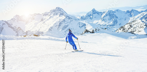Tuinposter Wintersporten Young athlete skiing in Deux Alps french mountains on sunny day