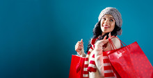 Happy Young Woman Holding Shop...