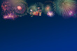 Colorful Fireworks on blue twilight background with copy space at the bottom for text insertion or decoration, holiday celebration concept