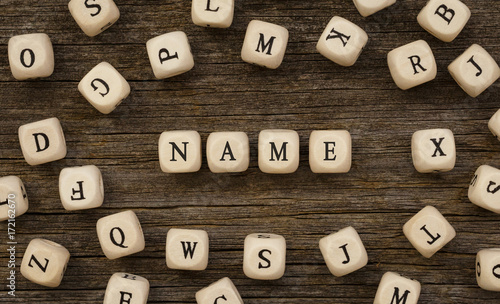 Fotomural  Word NAME written on wood block