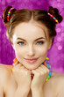 Bright girl model holding hands from face. Beautiful, stylish, young woman in a candy doll style with massive beads around her neck