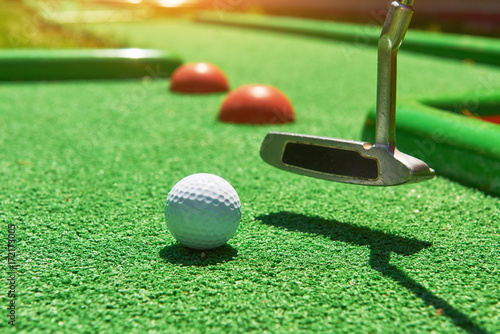 Golf ball and Golf Club on Artificial Grass