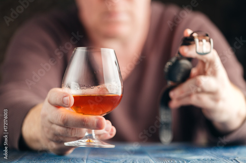 Spoed Foto op Canvas Bar problem of alcoholism, man stop drinking more