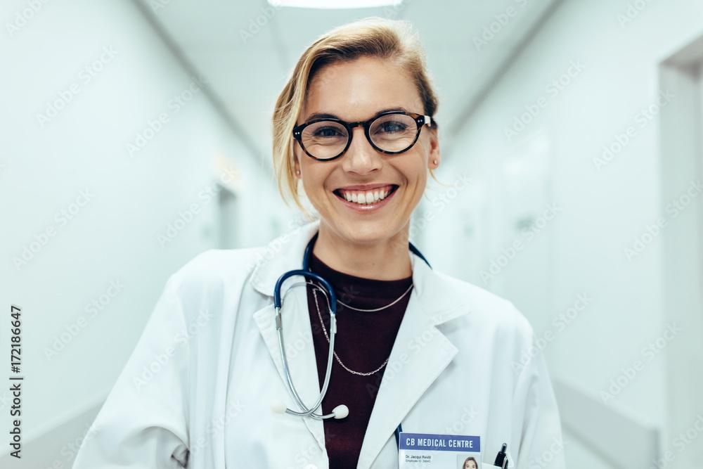Fototapety, obrazy: Female doctor standing in hospital corridor