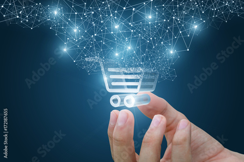 Photo Shopping cart as part of the network in hand .