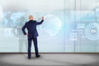 Businessman in front of a wall writing on a technology business futuristic interface - business concept