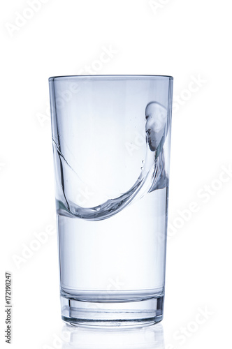 Papiers peints Eau Pure water splashing out of glass on white background