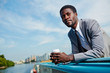 Calm businessman with drink contemplating during travel by steamship
