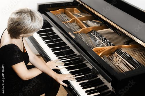 Wall Murals Music Piano player. Pianist woman playing grand piano