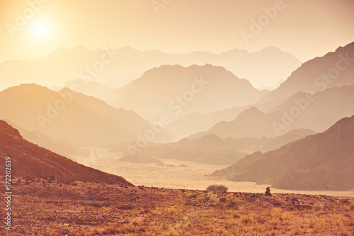 Valley in the Sinai desert with mountains and sun - 172202639