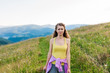 young fitness woman trail runner running on mountains top
