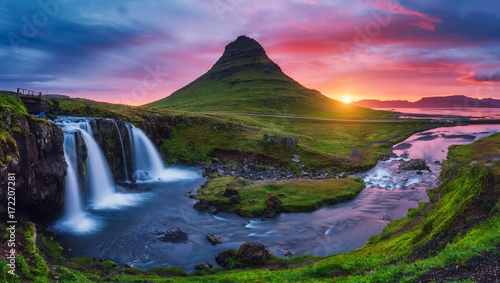 Majestic sunrise with Kirkjufell volcano the coast of Snaefellsnes peninsula. Location place Kirkjufellsfoss waterfall, Iceland, Europe.