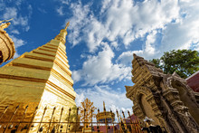 Wat Phra That Cho Hae Buddhism Temple With Golden Pagoda On Blue Sky Background. Places Worship Of Buddhists And Attractions Famous Religion At Phrae Province, Thailand