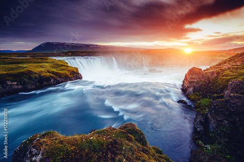 obraz lub plakat The rapid flow of water powerful Godafoss cascade. Location place Skjalfandafljot river, Iceland, Europe.