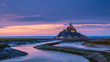 Panoramic view of famous Le Mont Saint-Michel tidal island at sunset, Normandy, northern France