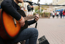 A Street Musician Playing The ...