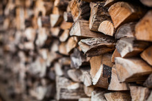 Beautiful Photo Background Of Heap Firewood Stack, Natural Wood For Publication In Magazine Or Advertisement