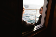 Two Women, Just Seen, Look Out Over The Bosphorus On Their Istanbul Ferry Journey.