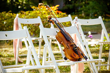 Violin On A White Chair