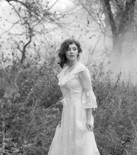c506108aad9 lady in gorgeous vintage white dress in the forest. Black and white ...