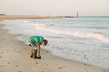 Child Collects Pebbles From Th...
