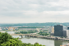 Cityscape Or Skyline View Of Allegheny And Ohio Rivers And Heinz Field With Bridge In Pittsburgh, USA