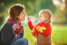 Little Girl And Her Mother Pla...