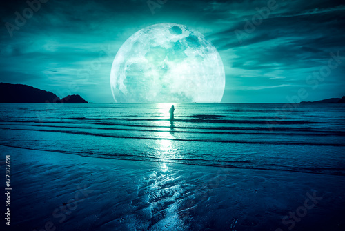 Tuinposter Groen blauw Super moon. Colorful sky with cloud and bright full moon over seascape.