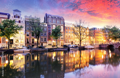 Poster Amsterdam Sunset city view of Amsterdam, the Netherlands with Amstel river