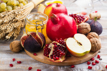 Autumn Harvest Concept - Fruits, Wine And Nuts On Wooden Table. Selective Focus. Space For Text