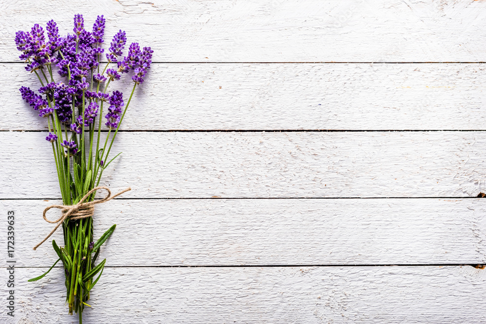Fototapety, obrazy: Fresh flowers of lavender bouquet, top view on white wooden background