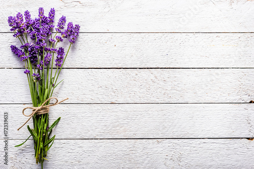 Foto op Aluminium Lavendel Fresh flowers of lavender bouquet, top view on white wooden background