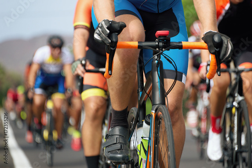 Foto op Plexiglas Fietsen Cycling competition,cyclist athletes riding a race,detail cycling shoes