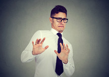 Disgusted Business Man Isolated On Gray Background