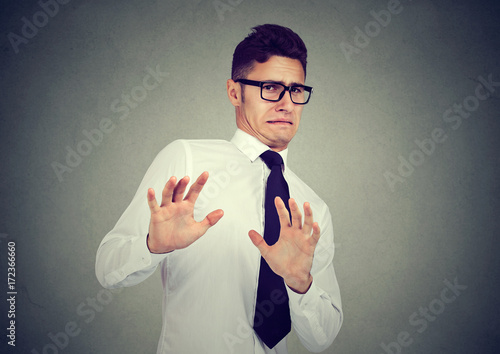 Fototapeta Disgusted business man isolated on gray background