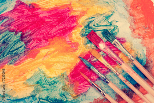 Dirty watercolor brushes and abstract painting