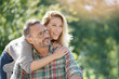 Leinwanddruck Bild - Portrait of mature couple enjoying sunny day in nature