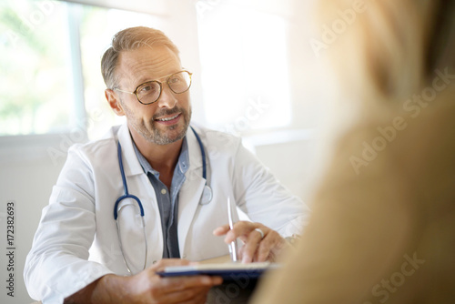 Doctor with patient in medical office Canvas Print