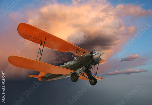 Fotografering  Old biplane in flight