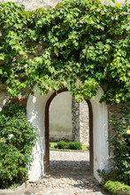 Arched Door In An Old Stone Bu...