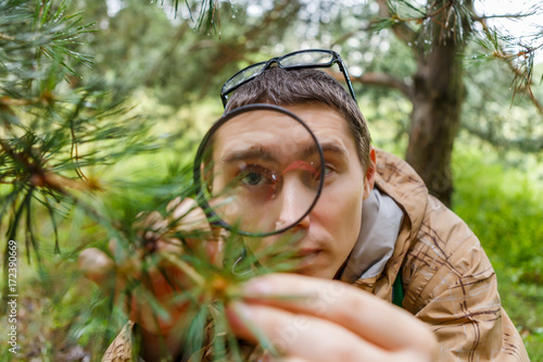 Picture of guy with magnifying glass Canvas Print